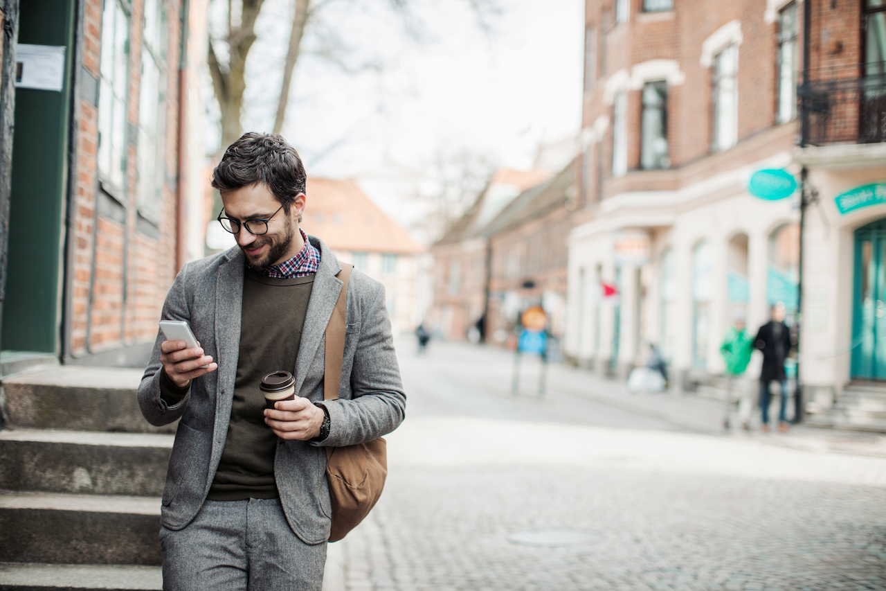 Photo of a businessman using mobile phone in the city