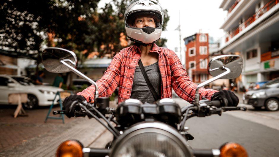 Filipino motorcyclist on motorcycle